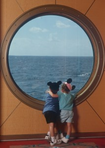 Kids Looking out Disney Cruise Porthole